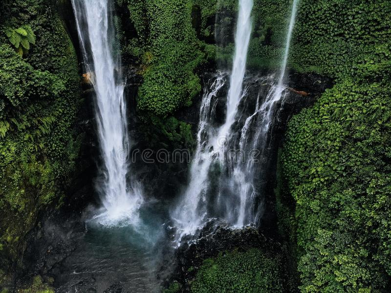 Aerial view of Sekumpul waterfall on Bali island Indonesia - travel and nature background. Drone photo stock images