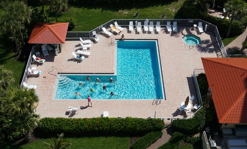 Aerial view of a senior water aerobics. Class in a resort pool during snowbird season in Florida stock images