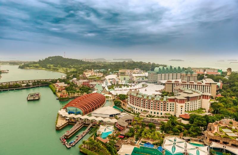 Aerial view on Sentosa island in Singapore. Singapore - Jan 13, 2018: Aerial view of the hotels, resorts and marina on Sentosa island in Singapore at the royalty free stock image