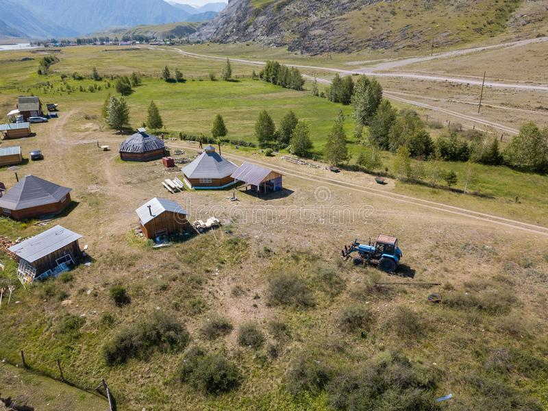 Aerial view of a settlement in the Altai Mountains with small houses for indigenous people and tourists, ail for nomadic living stock photo