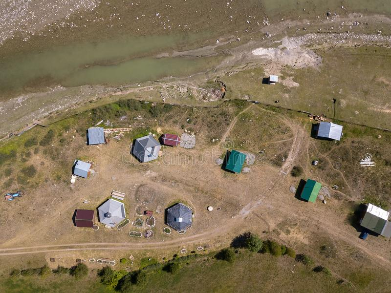 Aerial view of a settlement in the Altai Mountains with small houses for indigenous people and tourists, ail for nomadic living stock image