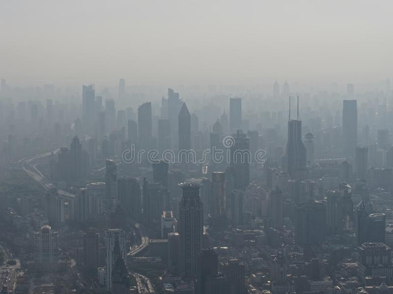 Aerial view of Shanghai city in fog, air pollution is a serious environment problem in China stock images
