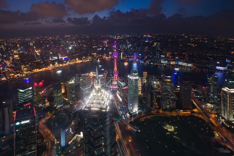 Aerial View of Shanghai Cityscape over the Pudong Financial District at night. Trade zone skyline and Huangpu River. stock image
