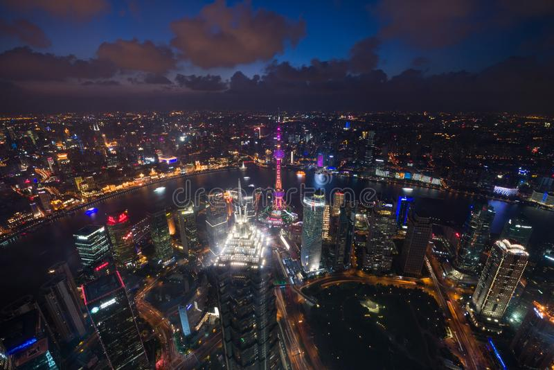 Aerial View of Shanghai Cityscape overlooking the Pudong Financial District at night. Trade zone skyline and Huangpu River. stock photos