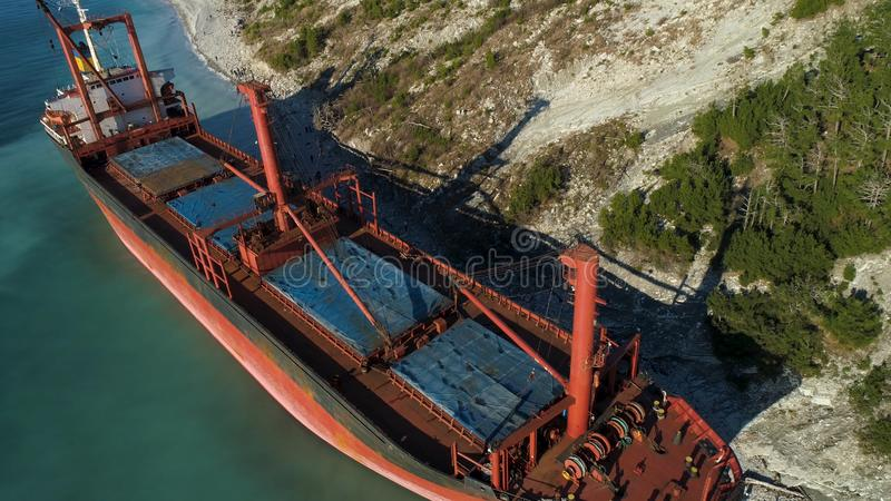 Aerial view of the ship washed ashore. Shot. Top view of an abandoned old and rusty shipwreck on a stormy day.  stock image
