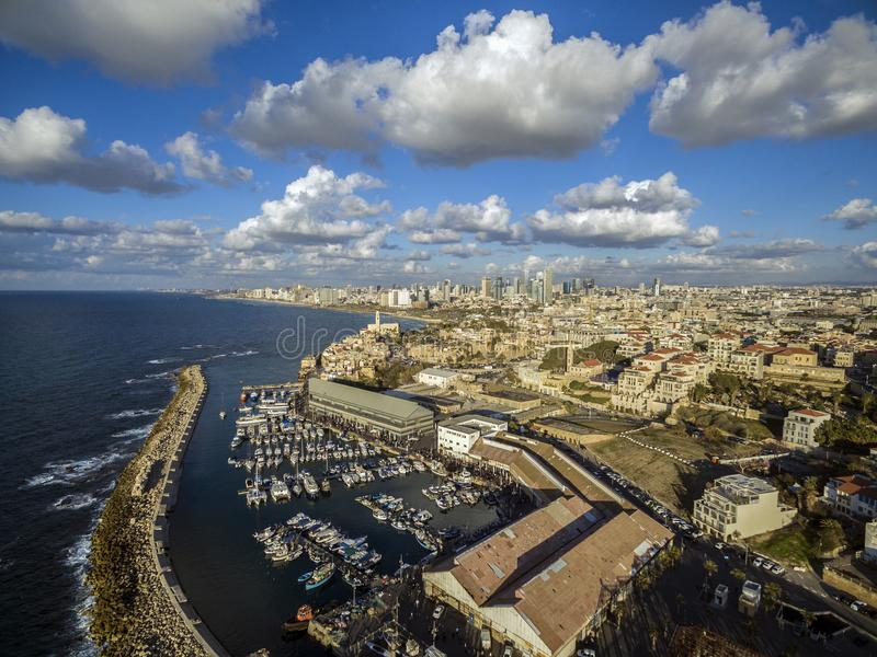 Aerial view of Ships anchoring at the Jaffa port. In a cloudy day. tel aviv skyline with urban skyscrapers at the background, Israel stock photography