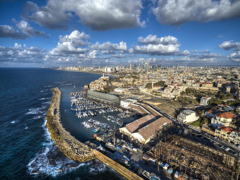 Aerial view of Ships anchoring at the Jaffa port in a cloudy day, Tel Aviv. Aerial view of Ships anchoring at the Jaffa port in a cloudy day. tel aviv skyline stock image