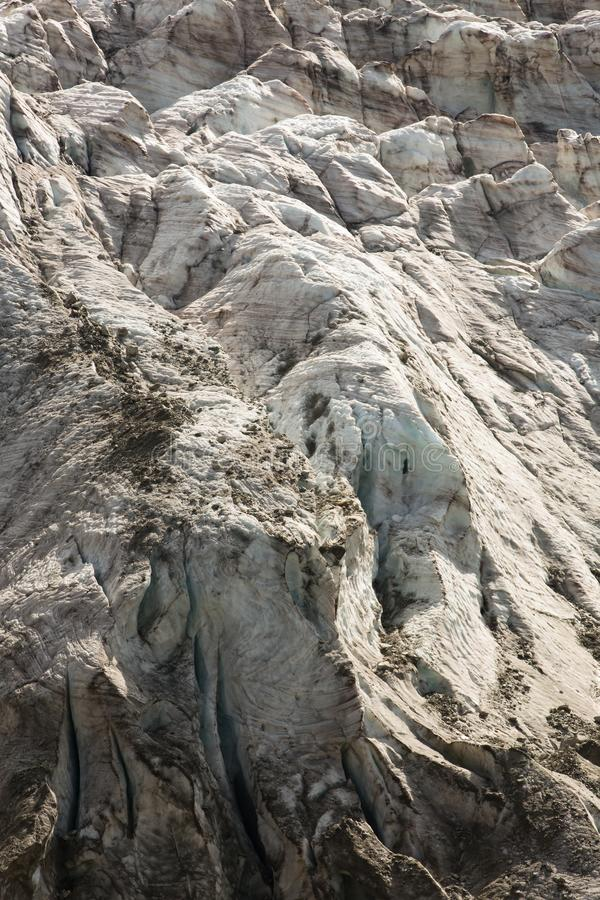 Aerial view of show and ice of Kashkatash Glacier on the west Ca. Ucasian mountains in Russia royalty free stock image