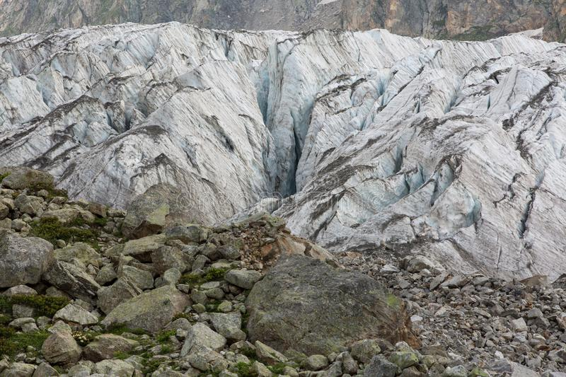 Aerial view of show and ice of Kashkatash Glacier on the west Ca. Ucasian mountains in Russia royalty free stock photos