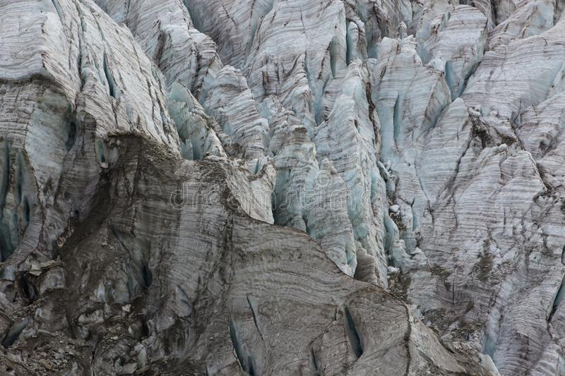 Aerial view of show and ice of Kashkatash Glacier on the west Ca. Ucasian mountains in Russia stock photography