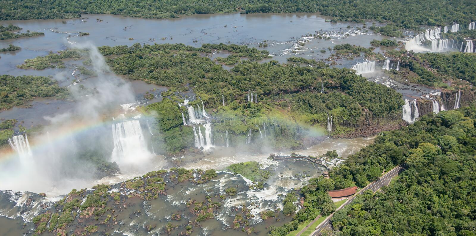 Aerial view showing entire Iguassu Falls from the air on  the Brazil side. Helicopter view of the waterfalls at Iguassu in South America  Rainbow and stock photos