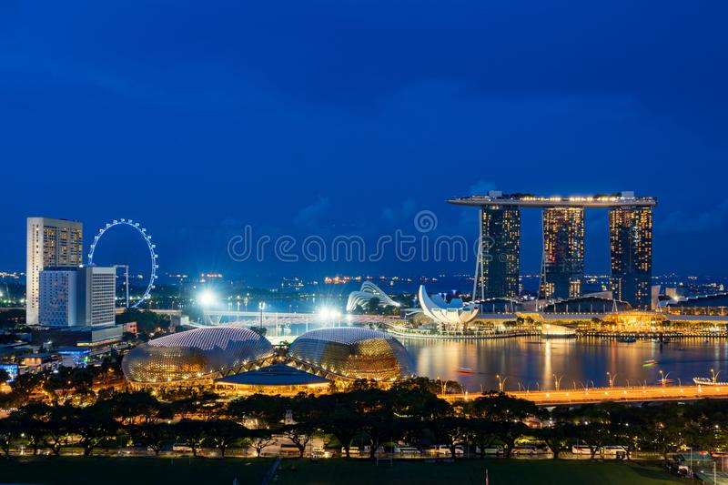 Aerial view of Singapore business district and city at night in Singapore, Asia.  stock photos