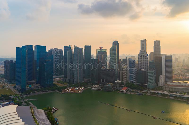 Aerial view of Singapore Downtown skyline at sunset. Financial district and business centers in technology smart urban city in. Asia. Skyscraper and high-rise royalty free stock photo