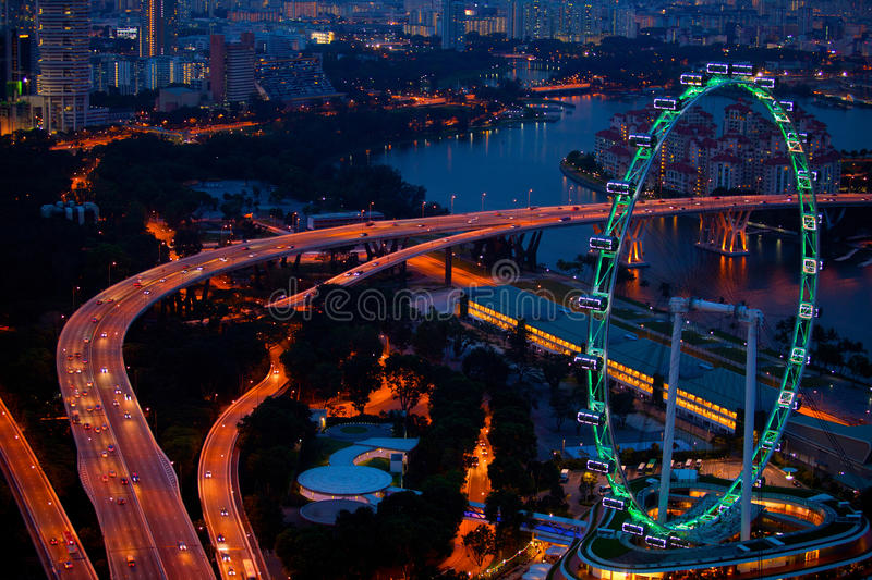 Aerial view on Singapore Flyer. From Marina Bay Sands resort at night royalty free stock images