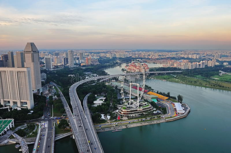 Aerial view of Singapore Marina Bay and Flyer. Aerial view of Singapore Marina Bay area with famous landmark such as Benjamin Sheares Bridge and Singapore Flyer royalty free stock photography