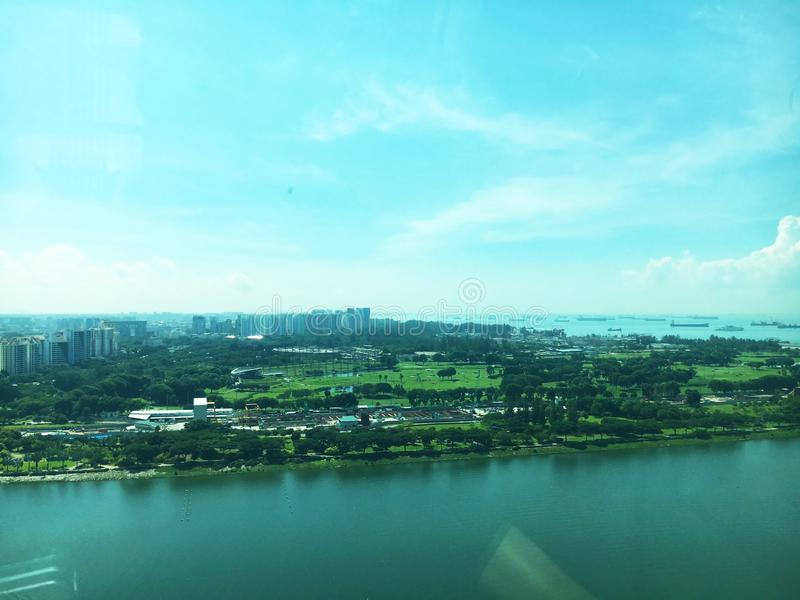 Aerial view of the Singapore seascape, landscape and blue sky shot during the daytime stock photos