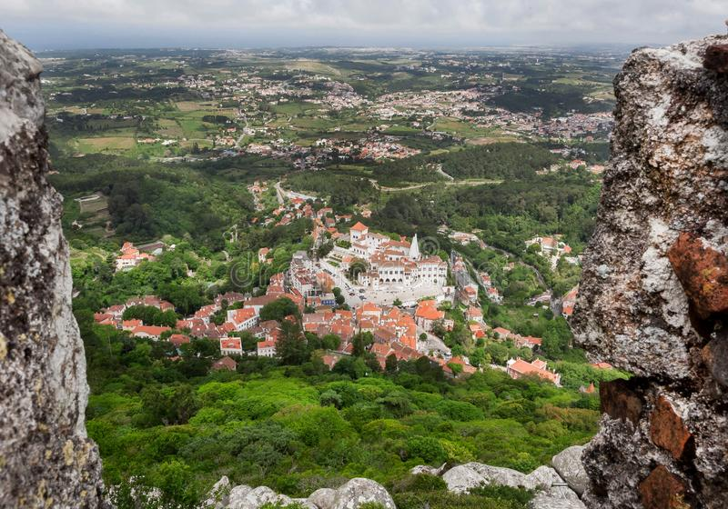 Aerial view on Sintra streets with trees, tile roofs. historical brick houses, Portugal. Aerial view on Sintra streets with green trees, tile roofs. historical royalty free stock photography