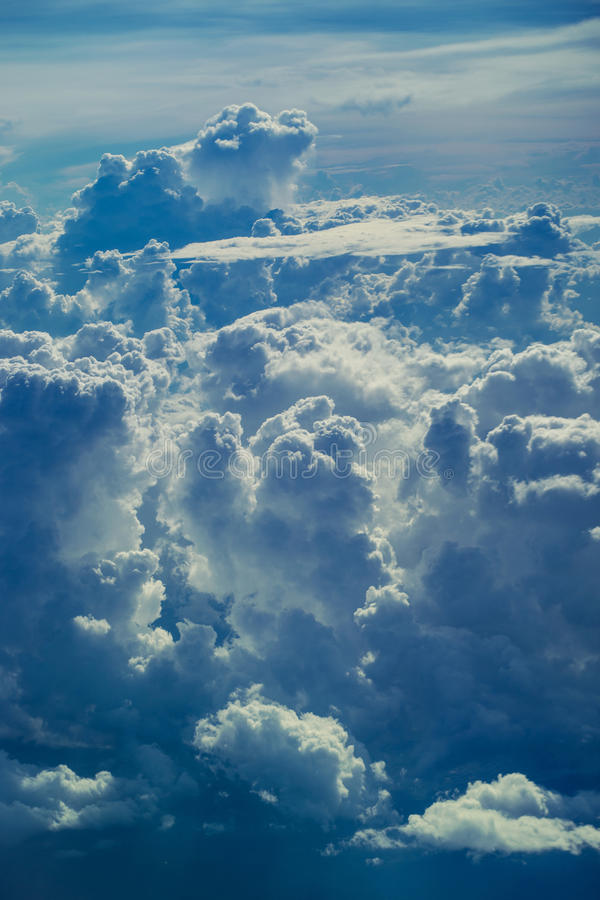 Aerial view through sky above the clouds abstract background. royalty free stock photo
