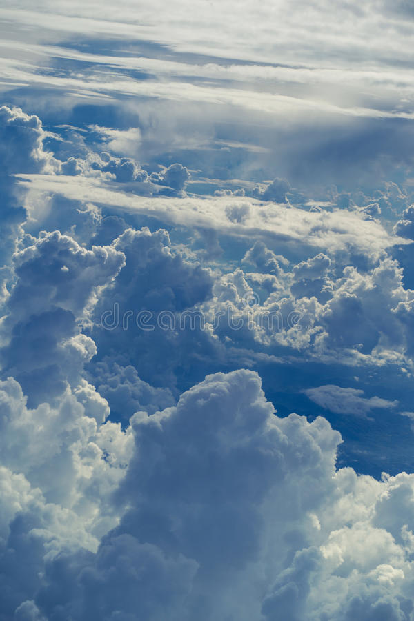 Aerial view through sky above the clouds abstract background. stock images