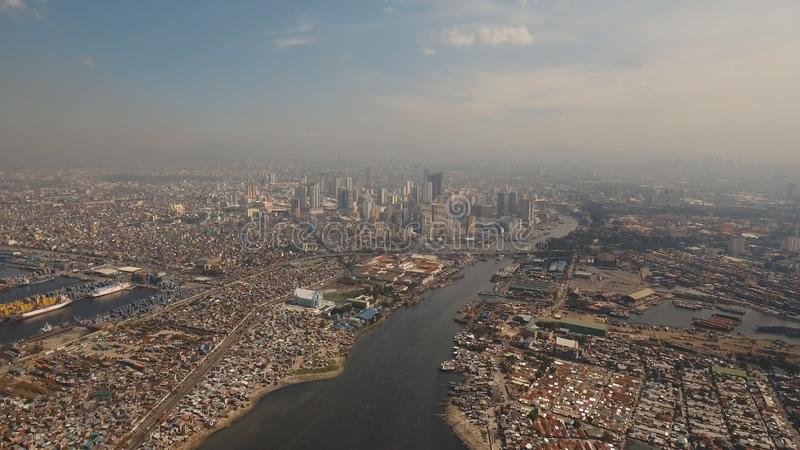 Aerial city with skyscrapers and buildings. Philippines, Manila, Makati. Aerial view skyline of Manila city. Fly over city with skyscrapers and buildings stock photos