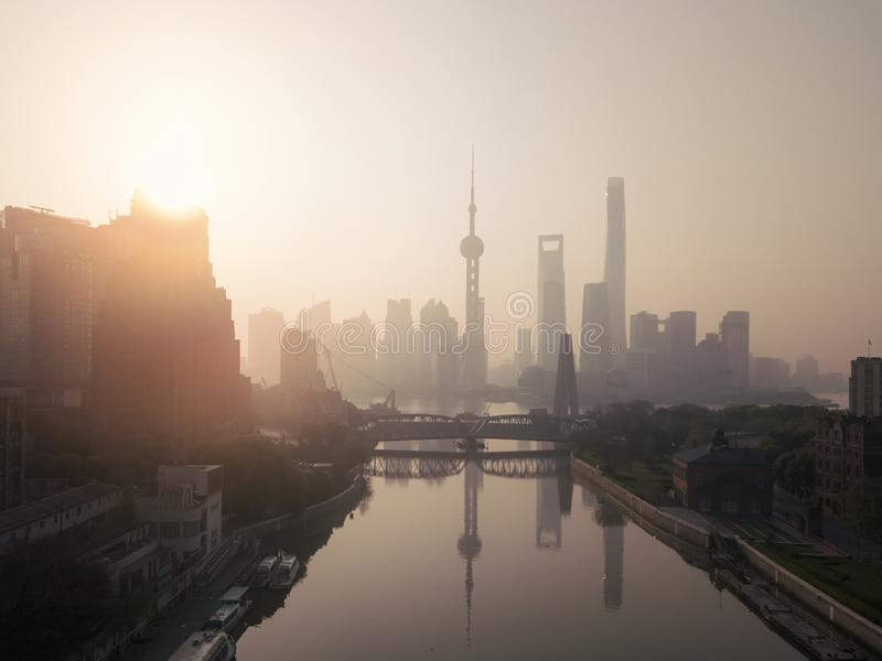 Aerial view of skyscraper and high-rise office buildings in Shanghai Downtown with fog, China. Financial district and business. Centers in smart city in Asia at stock photo
