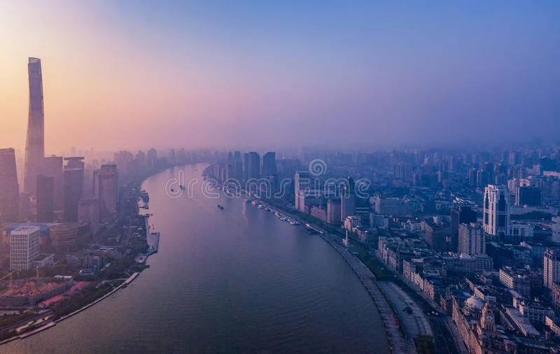 Aerial view of skyscraper and high-rise office buildings in Shanghai Downtown with fog, China. Financial district and business. Centers in smart city in Asia at royalty free stock photography