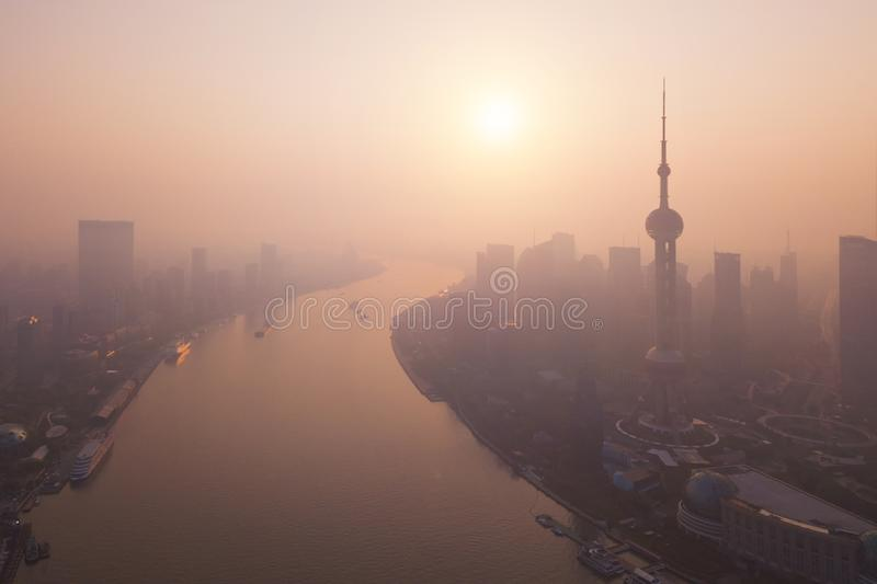 Aerial view of skyscraper and high-rise office buildings in Shanghai Downtown with fog, China. Financial district and business. Centers in smart city in Asia at stock image