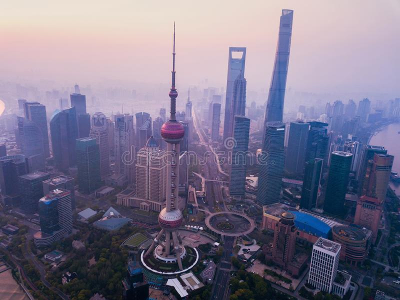 Aerial view of skyscraper and high-rise office buildings in Shanghai Downtown with fog, China. Financial district and business. Centers in smart city in Asia at royalty free stock images