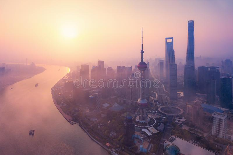 Aerial view of skyscraper and high-rise office buildings in Shanghai Downtown with fog, China. Financial district and business. Centers in smart city in Asia at royalty free stock photo