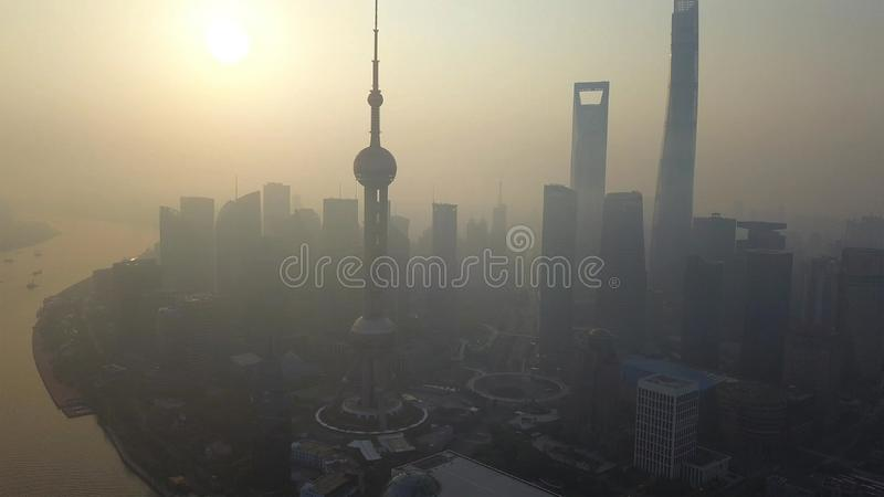 Aerial view of skyscraper and high-rise office buildings in Shanghai Downtown with fog or mist, China. Financial district and. Business centers in smart city in stock photo