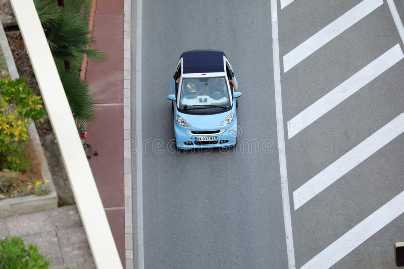 Aerial View Of A Small City Car Blue Smart Fortwo Brabus Driving. Monte-Carlo, Monaco - October 5 2018 : Aerial View Of A Small City Car Blue Smart Fortwo Brabus royalty free stock photos