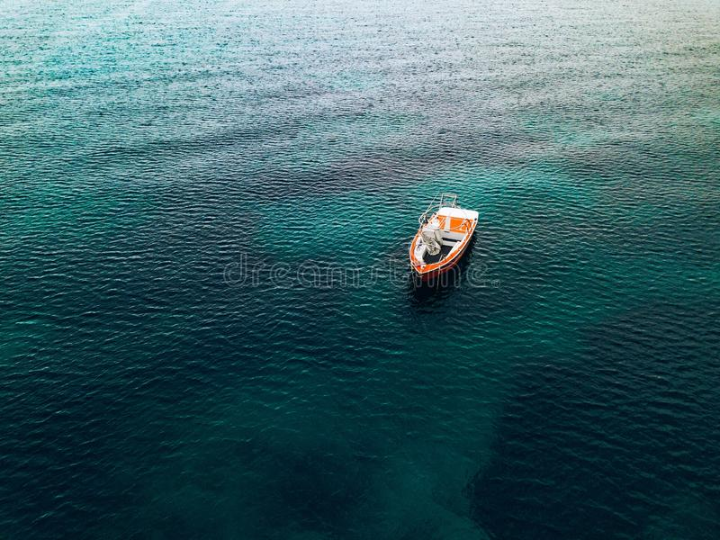 Aerial view of small fishing boat at sea, Greece stock photo