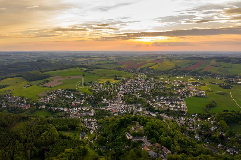Aerial view of a small germany town - sunset scene with beautiful sky. Aerial view of a small germany town called hartenstein - sunset scene with beautiful sky stock photos