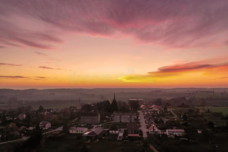 Aerial view of a small germany village - sunset scene with beautiful sky stock images