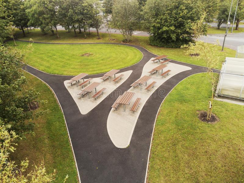 Aerial view, Small picnic area in a park, Metal and plastic materials used to make table and chair. Wheel chair accessible.Modern. Design, Small smoking area stock photos