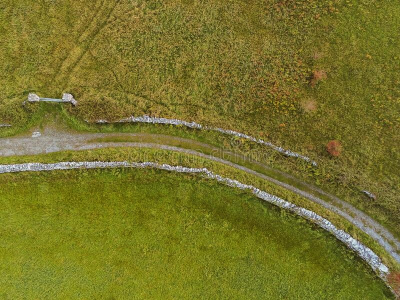 Aerial view small road in mountains, rock texture and stone fences, Burren, Ireland. Nobody royalty free stock image