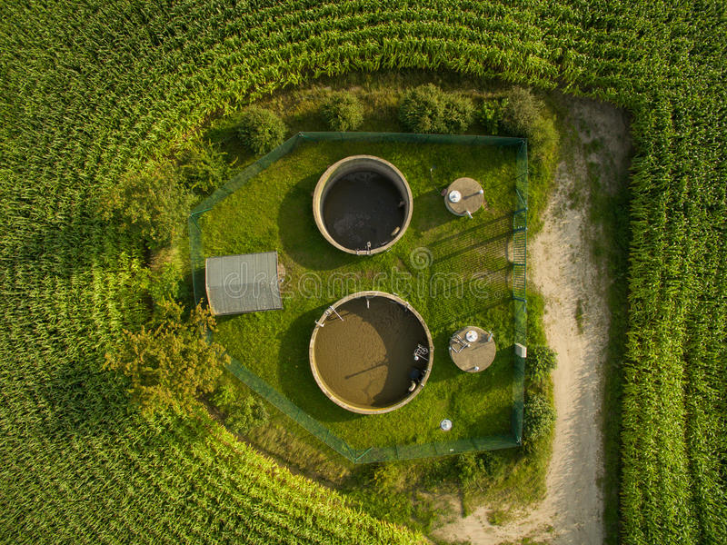 Aerial view of small sewage treatment plant betwenn corn plants fields - top view royalty free stock photo