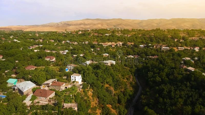 Aerial view of small village, monitoring ecology situation in mountainous area stock photography