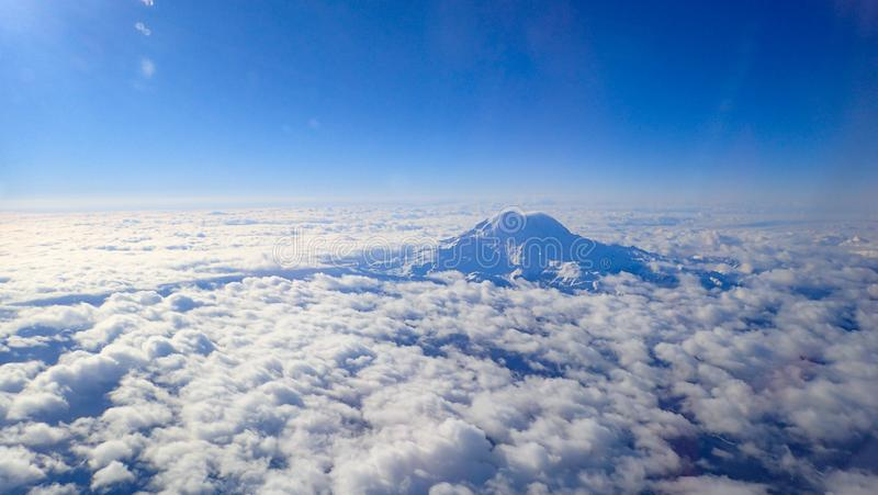 Aerial view of snow covered Mt. Rainier royalty free stock images