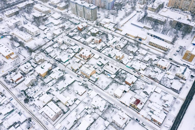 Aerial view of snow covered rooftops in residential area in city royalty free stock photography