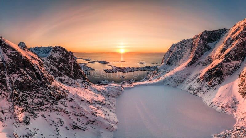 Aerial view of Snow mountain range with frozen lake on Reinebringen stock photos
