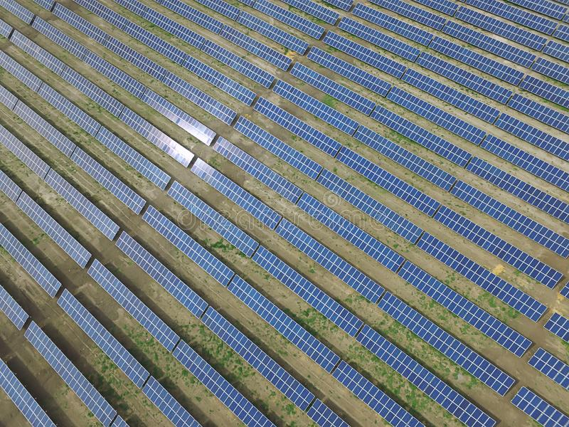 Aerial view of a solar farm producing clean renewable sun energy. Industrial landscape royalty free stock photos