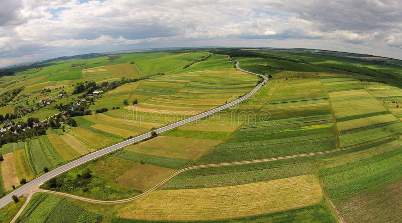 Aerial view of the sown fields near the motorway royalty free stock image