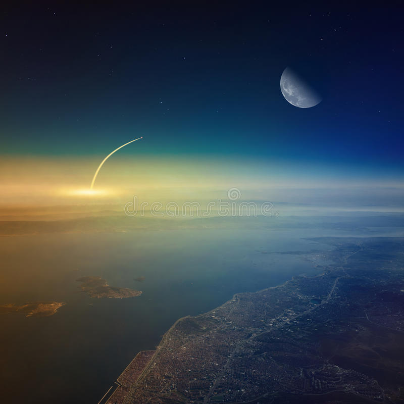Aerial view of space shuttle taking off. Missile launch, aerial view of space shuttle taking off, mission to moon. Elements of this image furnished by NASA stock images