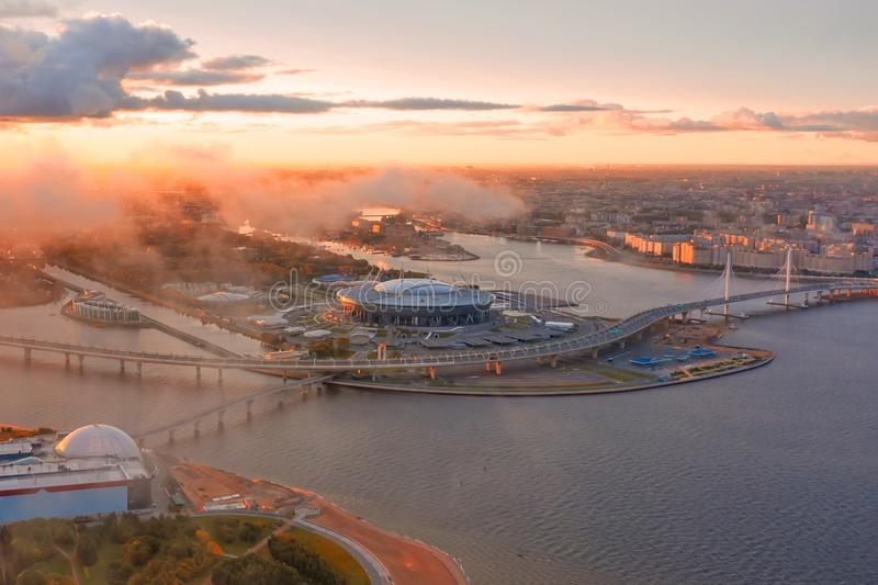 Aerial view of Stadium Zenit Arena panorama coast of the Gulf of Finland and the islands of the city, low morning clouds fog. royalty free stock photo