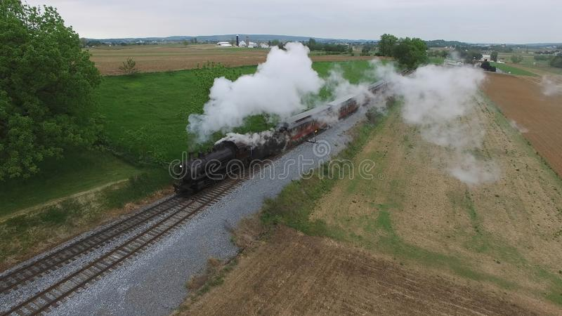 Steam Passenger Train Puffing Smoke in amish Countryside 25. Aerial View of a Steam Passenger Train Puffing Smoke in Amish Countrye on a Sunny Spring Day royalty free stock images