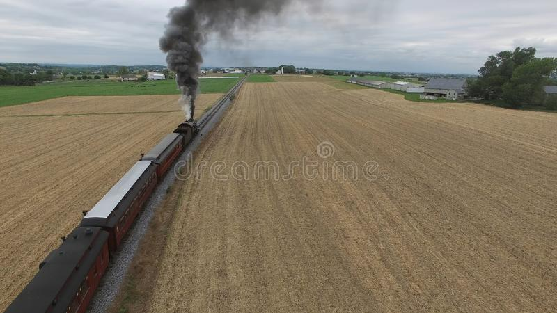 Steam Passenger Train Puffing Smoke in amish Countryside 7. Aerial View of a Steam Passenger Train Puffing Smoke in Amish Countryside on a Sunny Spring Day royalty free stock images