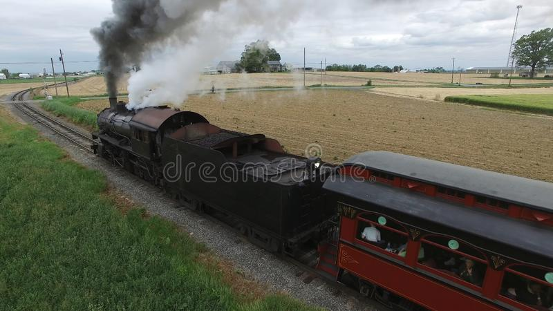 Steam Passenger Train Puffing Smoke in amish Countryside 4. Aerial View of a Steam Passenger Train Puffing Smoke in Amish Countryside on a Sunny Spring Day royalty free stock photography