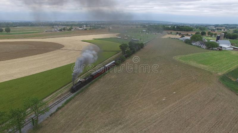 Steam Passenger Train Puffing Smoke in amish Countryside 13. Aerial View of a Steam Passenger Train Puffing Smoke in Amish Countryside on a Sunny Spring Day stock images