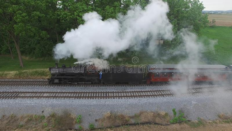 Steam Passenger Train Puffing Smoke in amish Countryside 26. Aerial View of a Steam Passenger Train Puffing Smoke in Amish Countryside on a Sunny Spring Day royalty free stock photography